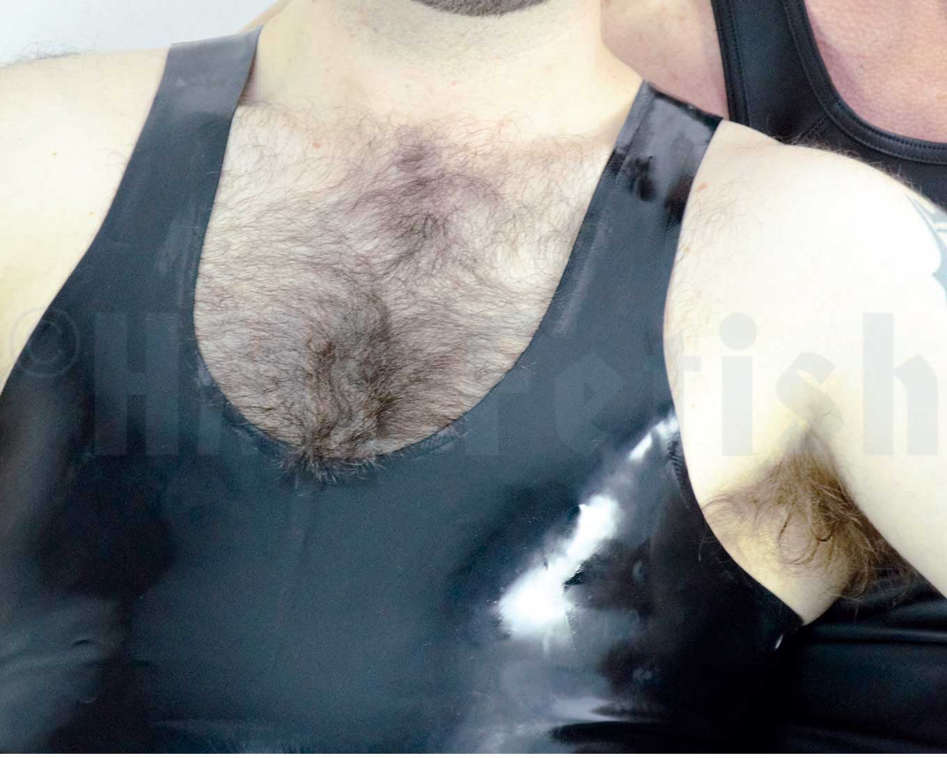 Rubber Tank Black latex tank-top with skin-tight, body-forming fit. 0.35 mm fine latex rubber quality. Available in sizes S, M, L, XL and XXL (+ 10 €). Like your rubber clothes to look shiny? Get one of our rubber care for it!