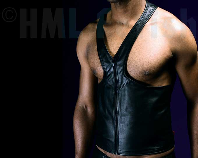 Wrestler Leather Top This is a tank-top made of a very fine black nappa leather - with a nice smooth feeling and perfectly manufactured. The cut is in wrestlers' style, with free moving space for your shoulders and arms. There is a discrete front zipper making it more comfortable to put on and to  wear it skintight to the body. We offer this tough looking tank in chest sizes. We sell it to you in chest sizes from S - XXL.